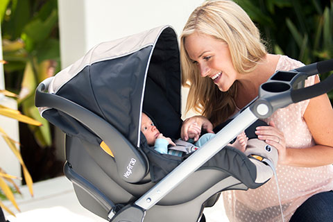 baby boppy chair recall swivel uk about our brand mom smiling at in chicco stroller