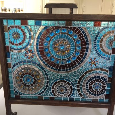 Mosaic fire screen - glass and bead mosaic - 70cms by 45 cms - by Claudia Parker