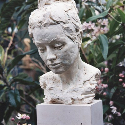 Zoe - Cast white marble on limestone base - Approx. H = 16 inches x W = 11 inches x D = 8 inches - by Susan Hadley