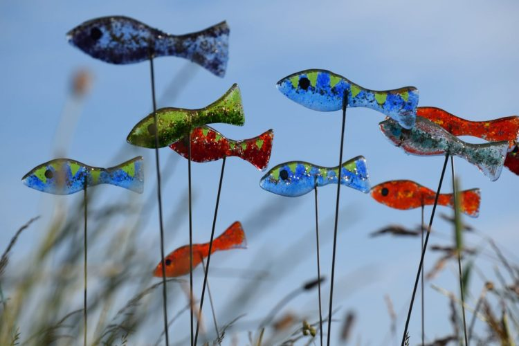 Shoal of fused glass fish - Glass