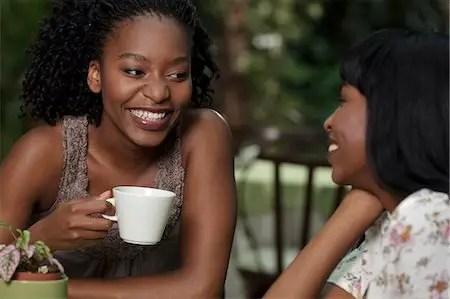 African women drinking osang tea (Equatorial Guinea) together