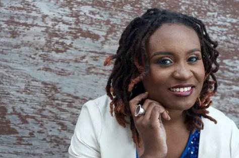 Black woman professionally dressed with dreadlocks