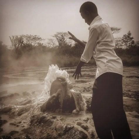 Nkundwa plays around at the geyser, Sempaya Springs, Semuliki National Park, Uganda