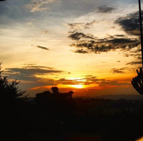 The sun sets over Mutungo Hill, Kampala seen from Afrique Suites Hotel.