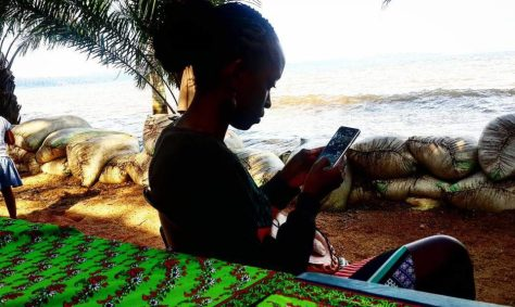 My cousin on the shores of Lake Victoria