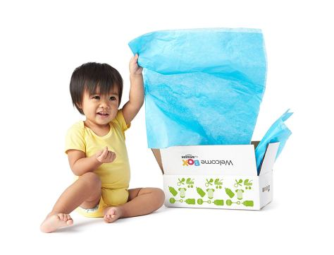 Asian child with Amazon baby registry welcome box