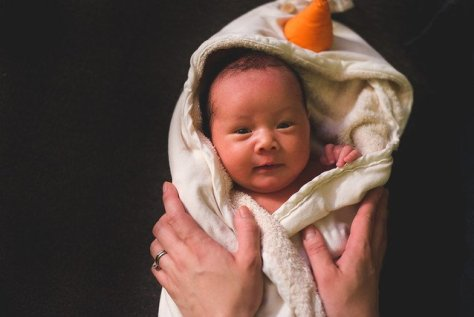 Baby in a hooded towel