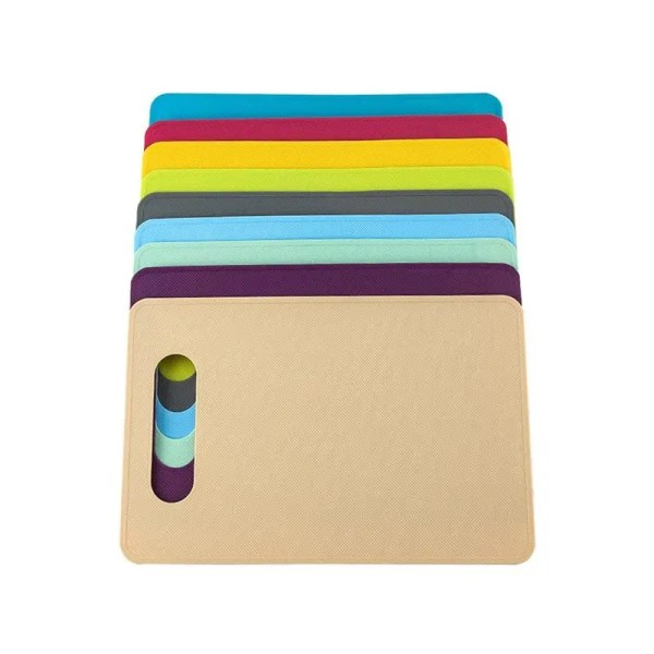 Multicolored cutting boards stacked against one another