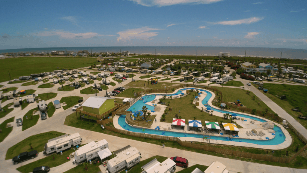 Looking for a campground that has two swimming pools, splash pad, pirate-themed miniature golf, outdoor movie theater, a multi-use trail to the bay, and public beach access across the street.