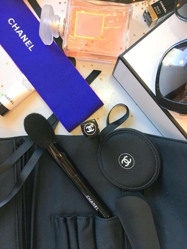 A flatlay of a Chanel blush brush