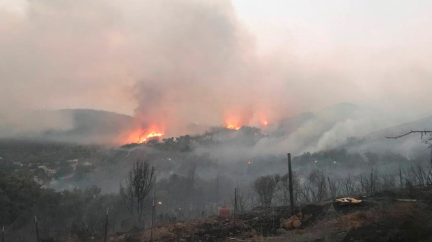 In this photo provided by the Cal Fire, the Pawnee Fire burns Sunday in the Spring Valley area, northeast of Clearlake Oaks in Lake County. (Jonathan Cox -- California Department of Forestry and Fire Protection via AP)