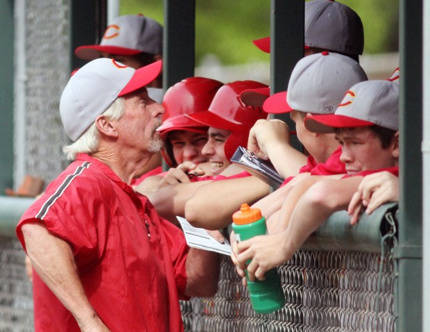 Chico High coach Chip Carton (left) talks to the team against Enterprise High in the top of the fourth inning during their baseball game at Skip McDonald Field Friday, April 27, 2012 in Chico, Calif. (Jason Halley/Chico Enterprise-Record)