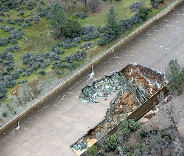 Department Of Water Resources Officials Look At The Gap In The Oroville Dam Spillway Where A Concrete Section Eroded Tuesday On The Middle Section Of The