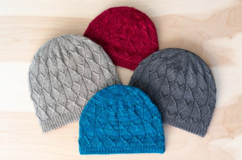 Expanded size range of the Sérac Hat: adult, child, and baby.