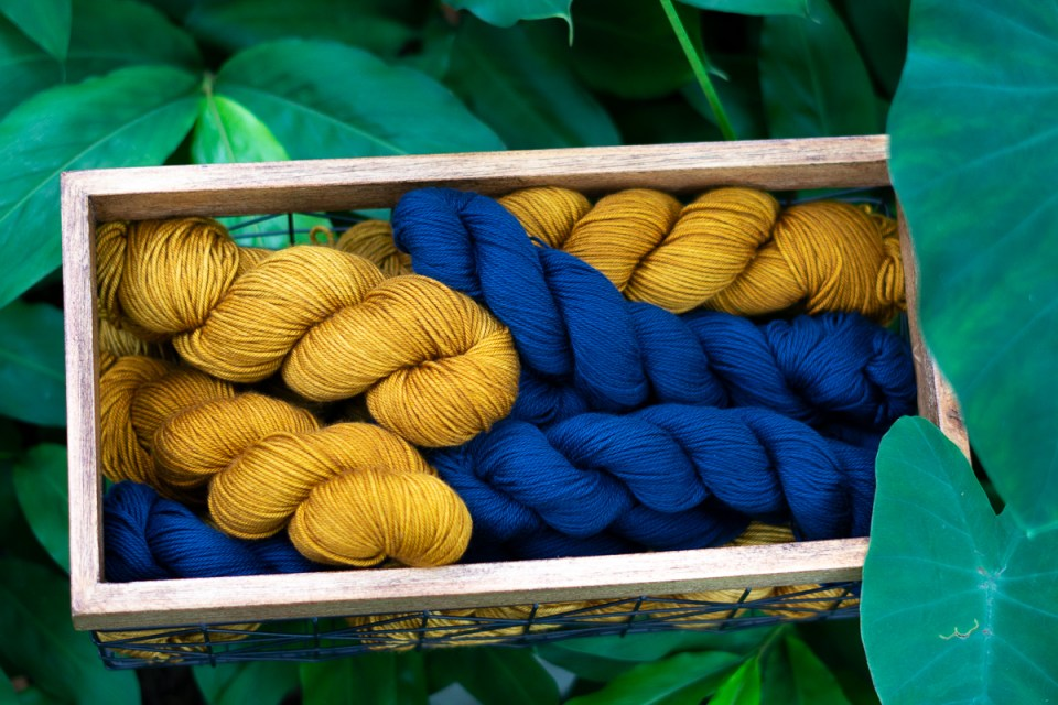 Yellow and blue yarn in the garden.