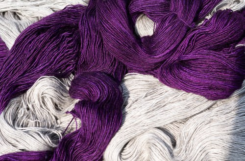 Purple yarn and gray yarn.
