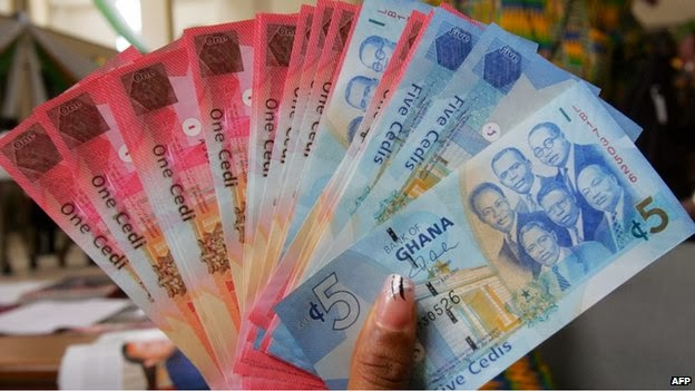 Ghana limits dollar transactions to protect cedi
