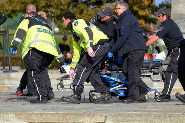 Gunman panics Ottawa, killing soldier in spree at Canadian capital