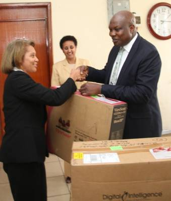 THE DIGITAL INTELLIGENCE DIVICES WHERE PRESENTED TO MR.     ILIYASU KWARBAI OF EFCC BY PAULA PARKINSON OF FBI WHILE DAHAB GEHRAB   LOOKS   ON. 035