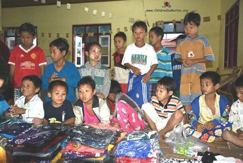 children with new clothes sasana orphanage myanmar - children do matter