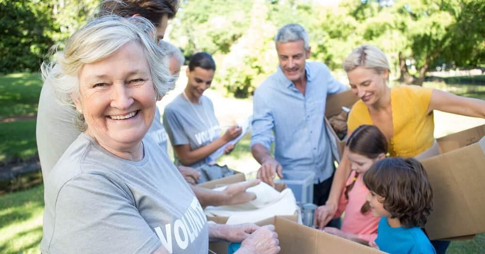 Volunteers helping hands