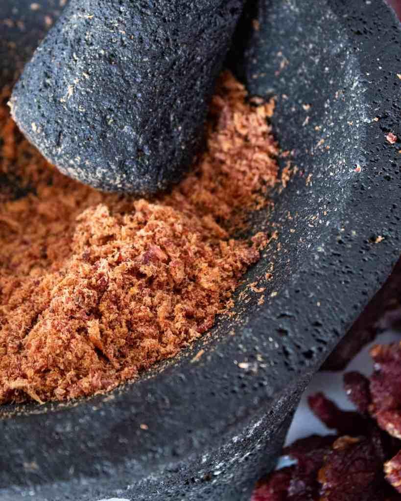 carne seca being ground into machaca