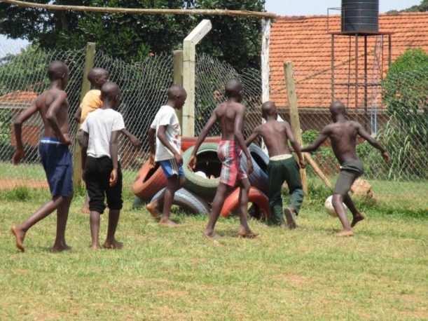 Former street kids playing football at one of the Dwelling Places homes. Such activities help them bond and get a sense of belonging.