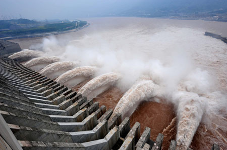 Flood water rushes through the sluice gates of the Three Gorges Dam (link from China Daily News)