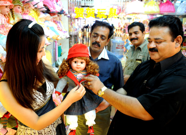 customers browsing a doll