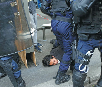 French Riot Police Apprehend A Man During Clashes With