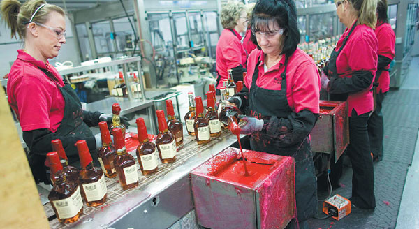 workers are busy on the production line at the maker s mark whiskey distillery in loretto