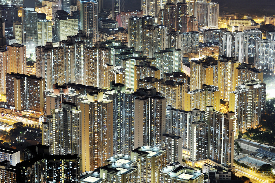 View of Hong Kong from Lion Rock, which overlooks Kowloon from the North, November 2011. Almost half of Hong Kong's population lives in public or government-subsidized housing. Lit up at night, the glowing public estate blocks are hard to distinguish from high-end luxury towers.