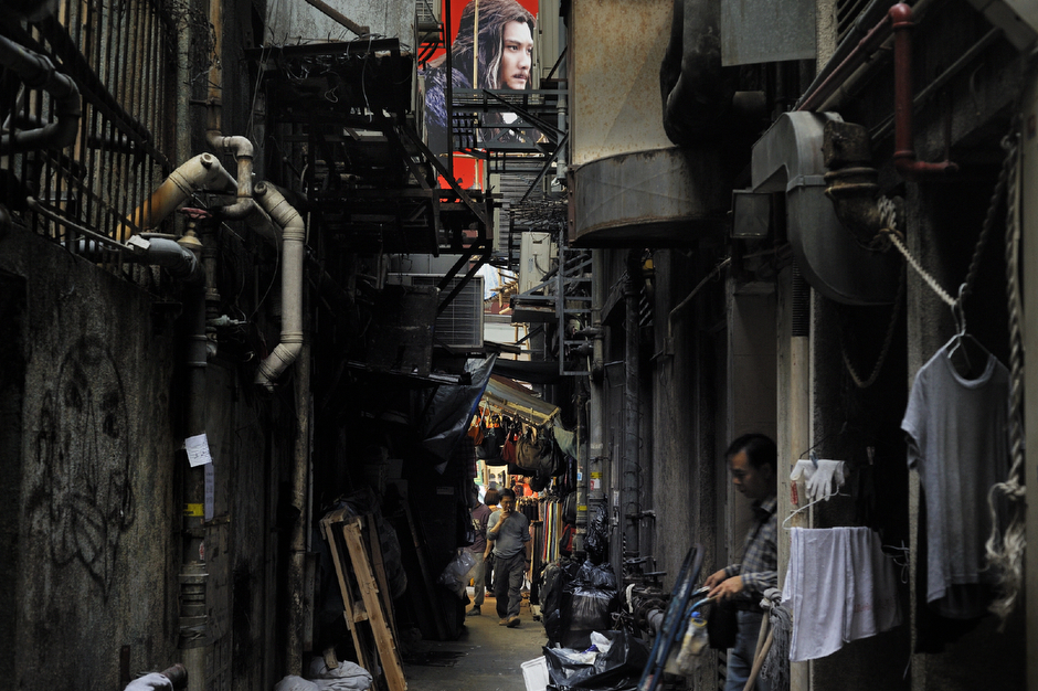 An ad for a Chinese movie above an alleyway in the Tsim Sha Tsui district.
