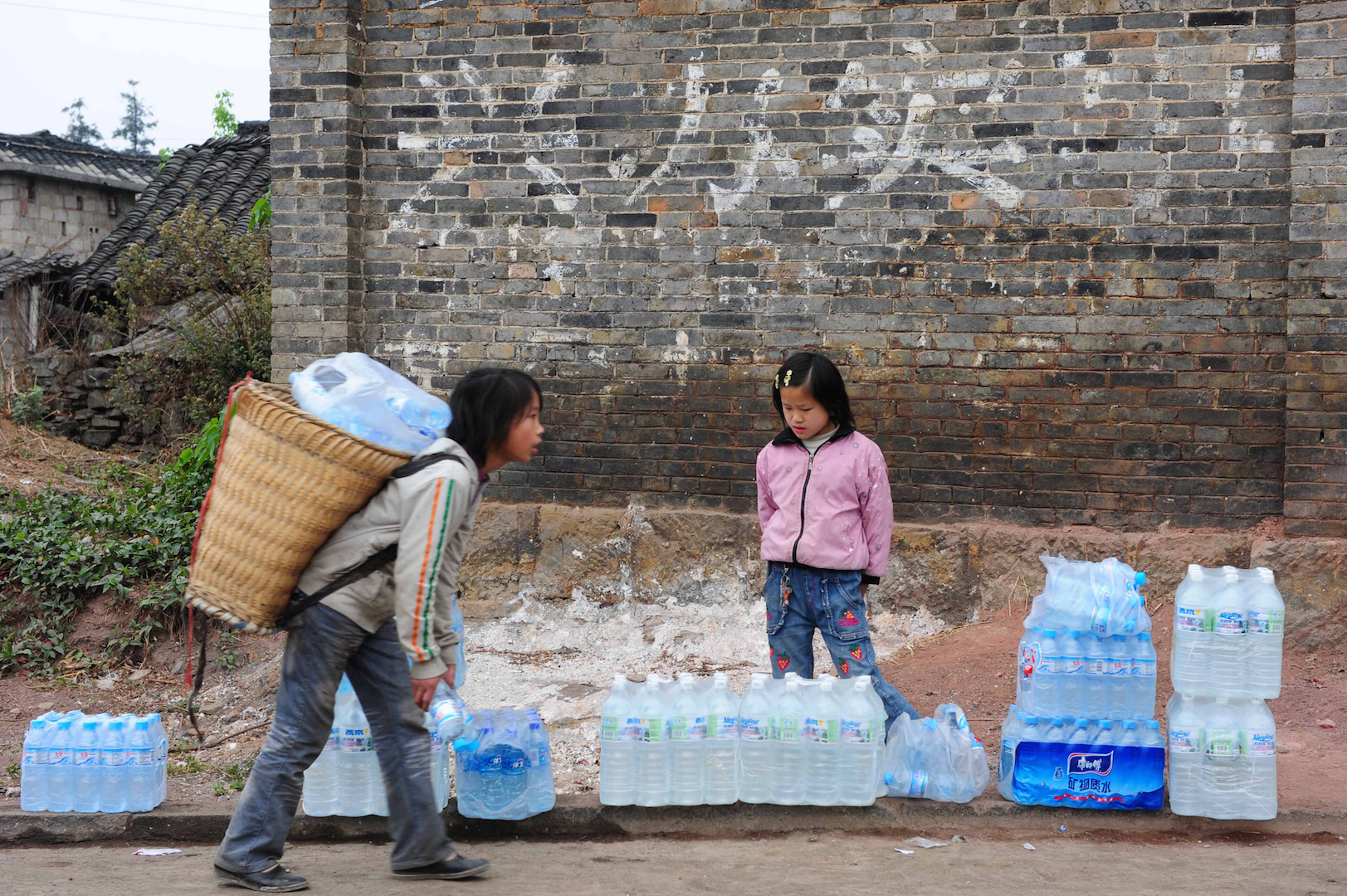 Image result for chinese carrying bottled water