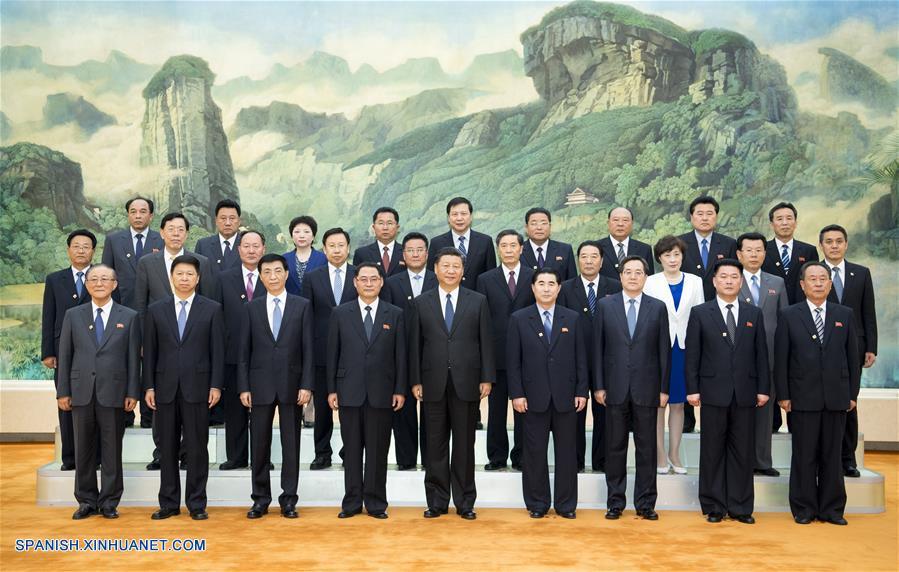 Xi se reúne con grupo visitante de amistad del PTC de la RPDC