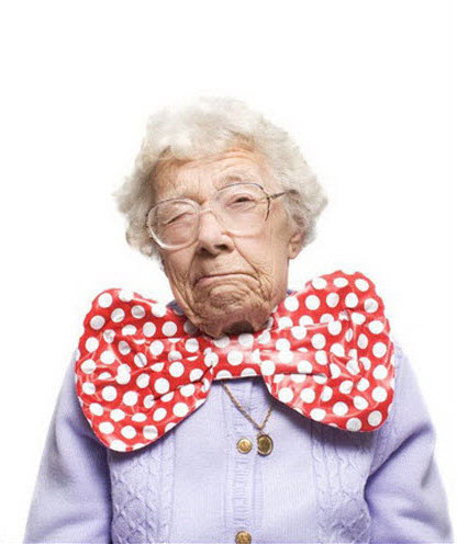 Crazy old lady wearing large polka-dotted bowtie.