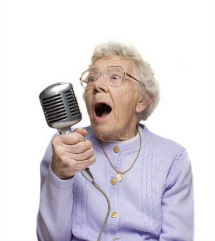 Crazy old lady singing into microphone.
