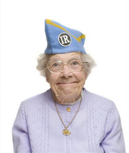Crazy old lady wearing light blue cap.