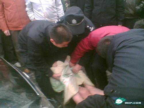 Chinese police officers try to subdue Brother Power.