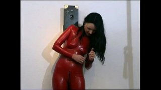 Horny girl posing in latex outfit