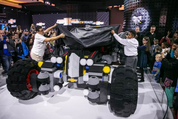 Students from Detroit's Cody Rouge community, A World in Motion and FIRST LEGO League unveil the life-size LEGO Batmobile Saturday, January 14, 2017 on opening day of the North American International Auto Show in Detroit, Michigan. The 17-foot long vehicle was inspired by Batman's Speedwagon featured in The LEGO Batman Movie, which hits U.S. theaters on Feb. 10. (Photo by John F. Martin for Chevrolet)