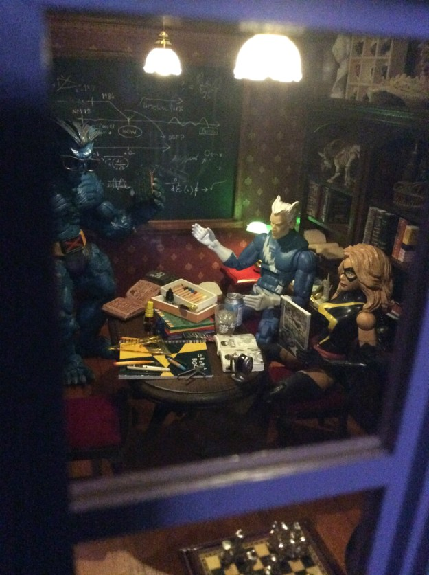 X Men dollhouse library through window by Suzanne Forbes July 18 2019