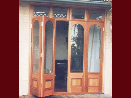 past joinery job by fold arched top french doors