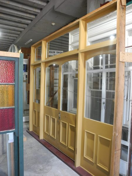 set of flat arched french doors in frame with sidelight and fanlights