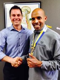 Pictured: Dr. Devin Young of Intouch Chiropractic and Boston Marathon Champion, Meb Keflezighi