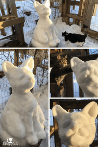 Snow sculpture of cat