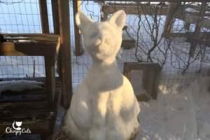 Snow cat sculpture