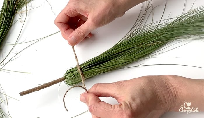 tie the witches broom cat toy in twine