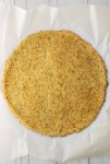 overhead shot of cauliflower crust on parchment paper