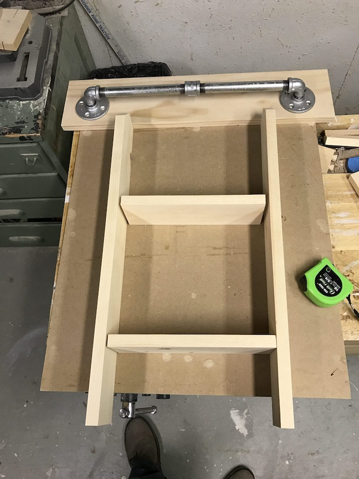 bathroom wall organizer before being stained